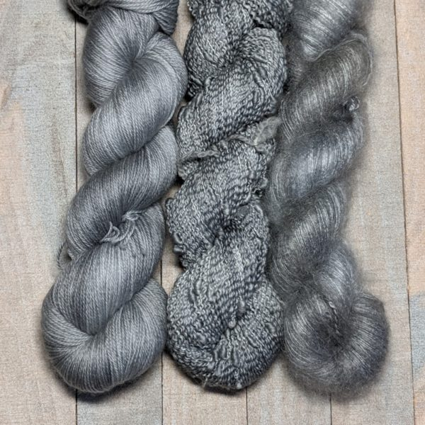 three skeins dyed in Rain Cloud gray